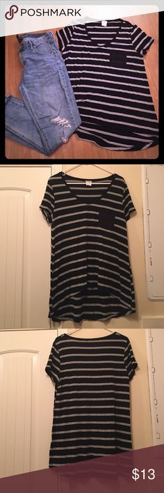 Charming Charlie Pocket T-Shirt Black and grey striped picket T-Shirt. Longer in back than in front. Loose fitting and very stretchy. Perfect basic to layer for the fall season! Lightly used. Charming Charlie Tops Tees - Short Sleeve