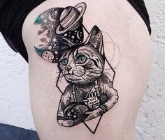 Tattoo on the thigh of the girl - cat and space