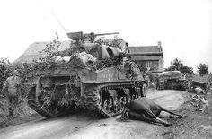 Sherman tanks fighting in Avranches, France. 1944.
