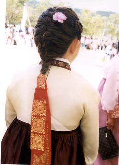 Daenggi - a traditional Korean ribbon made of cloth to tie and to decorate braided hair.