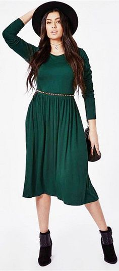 Fedora'd ravenette in forest Pleated tea-sleeve Dress, black lowcut boots