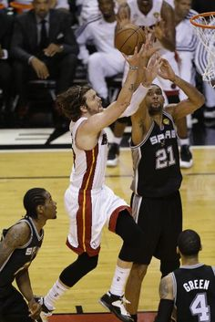 Miami Heat shooting guard Mike Miller (13) drives to the basket against San Antonio Spurs power forward Tim Duncan (21) during the second half of Game 6 of the NBA Finals basketball game, Tuesday, June 18, 2013 in Miami