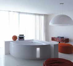 Modern bathroom with Treesse's corner bathtub with lighted panel / Slide Collection