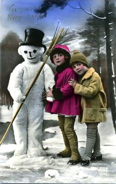 old photo postcard with snowman and children