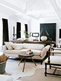 Darryl Carter living room with layered cowhide rug on Thou Swell @thouswellblog