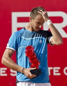 Lukas Rosol of the Czech Republic reacts after his victory in the BRD Nastase Tiriac 2013 Trophy ATP tennis tournament in Bucharest, Romania, Sunday, April 28, 2013. Rosol defeated Guillermo Garcia-Lopez of Spain in the final match. (AP Photo/Vadim Ghirda)