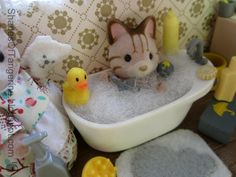 Tiny Things (Furniture Sets), she repurposed old games and other small toys parts for Calico Critters!