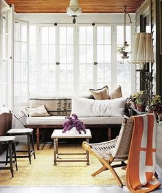 Floor to ceiling windows with cozy places to sit and a touch of orange? Yes, please!