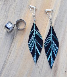 "Intrepid Jewelry - ""MAYA"" Silver and Blue Small Aztec Leather Feather Gauged Earrings by BellaDrops, $34.99 (http://www.intrepidjewelry.com/maya-silver-and-blue-small-aztec-leather-feather-gauged-earrings-by-belladrops/)"