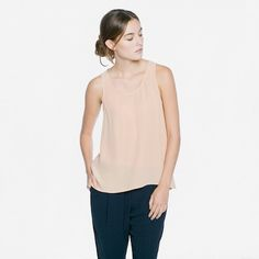 Luxury essentials without traditional retail markups. Everlane Silk Tank $55