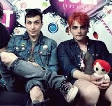 GERARD IS HOLDING A PLUSH TOY OF HIMSELF. MY LIFE IS COMPLETE.
