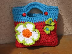 Ravelry: Girls Purse with Big Flower pattern by Eva Unger