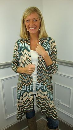 Our two favorite things (long open-front cardigans and missoni prints) collide in this AWESOME cardigan!! The colors are ivory, mocha and dark teal. Need I say more? Nah… the photo does all the talkin'!