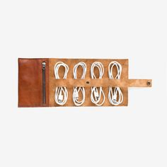 The new Cordito holds 4 cords, 2 plugs, and small knick knacks. A simple way to organize and stow your cords, plugs, and smaller gear. This updated design includes a zipper pocket to lock in your smal