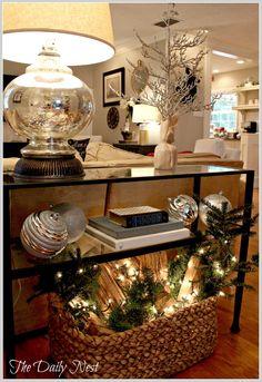 Love the basket w/ greenery, lights & logs