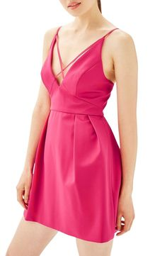 Don't stop dancing in this playfully pleated fit-and-flare dress made from pretty crepe with a plunging, crisscrossed neckline.