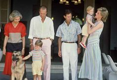 August 9, 1986:  King Juan Carlos of Spain (2nd-L) and his wife Queen Sophia of Greece (L), are surrounded in Palma de Mallorca by Prince Charles of Wales and his wife Princess Diana (R) and their children, young William and Harry (in Diana arms) and Juan Carlos' dog Arky. Juan Carlos was designated King of Spain 22 November 1975. Queen Sof�a was born in Athens 02 November 1938. She was the first daughter of King Paul I of Greece. AFP PHOTO (Photo credit should read /AFP/Getty Images)