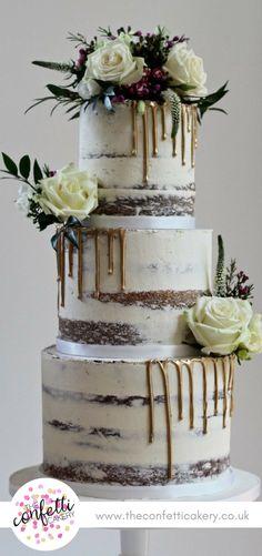 Semi-naked wedding cake with metallic gold chocolate drips, decorated with fresh flowers and foliage. Cake & Image: The Confetti Cakery. Venue: Doddington Hall.