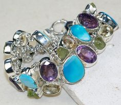 Arizona Turquoise,Amethyst Faceted,	Citrine Faceted ,Peridot Rough bracelet designed and created by Sizzling Silver. Please visit  www.sizzlingsilver.com. Product code: BR-8317