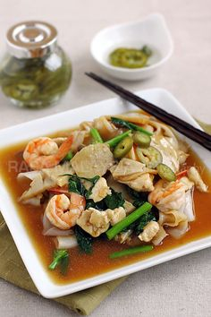 Rad na, or Rad Na Kuay Tiew is a Thai-Chinese noodle dish.-Regardless of its regional variation, it's always delicious and satisfying—fried rice noodles drenched in a savory sauce with seafood, meat, and vegetables…