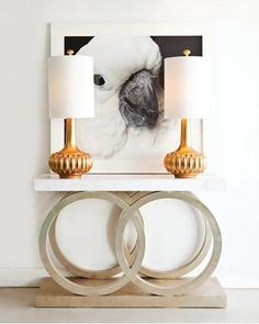 parrot photo, brass lamps, circles console console table
