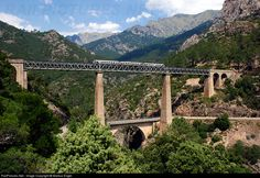 Train No 23 Bastia-Ajaccio crossing the Vecchio-Viaduct (length 140 m, height 80 m) buildt by Gustave Eiffel.