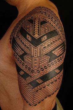 Polynesian sleeve tattoo.