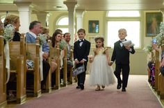 Flower girl and ring bearer outfit idea - flower girl in A-line dress with gold, sequin top and tulle skirt and ring bearers in black tuxes and black bow ties {Kasey Matson Photography}