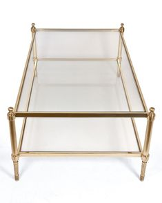 modern coffee table with brass legs | Maison Jansen Brass and Glass Coffee Table at 1stdibs