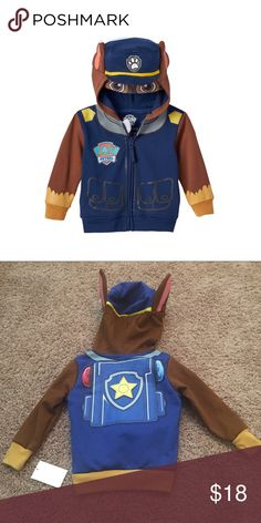 """Paw Patrol """"CHASE"""" Full Zip 3D Ears Hoodie NWT Paw Patrol """"CHASE"""" Full Zip 3D Ears Hoodie in Blue / Brown NWT  Product Details:  Treat your little guy to this boys' Paw Patrol costume hoodie, styled after Chase. In navy.  Product Features:  Zip front Long sleeves 2-pocket 3D hat, ears & mesh eyes on hood Chase outfit graphics Ribbed cuffs & hem Soft fleece lining Fabric & Care: Cotton, polyester Machine wash Imported  Condition: New  in package Nickelodeon Shirts & Tops"""
