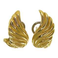 Gübelin 18 Karat Wing-Shaped Earrings. These lovely earrings consist of sculpted gold forming a wing-shaped drop earring. The earring measures 18.5mm wide x 9.6mm tall and have a short post and Omega clip back. Stamped on the bottom of the earrings is SWISS the Gübelin makers mark and 750. The total gold weight of the earrings is 7.49 grams. Animal Earrings, Bvlgari, Makers Mark, Omega, Sculpting, Fashion Brands, 18th, Vintage Jewelry, Wings