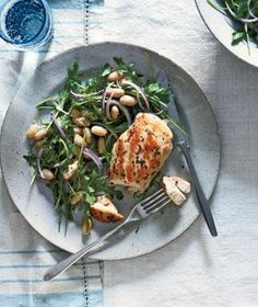 Rosemary Chicken With Arugula and White Beans recipe: A garlic and rosemary marinade makes the boneless, skinless breasts juicy and tender.
