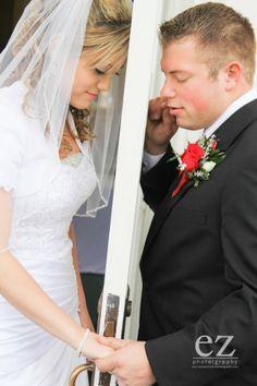 Zach & Whitney Bates praying before their wedding. {EZ photography}