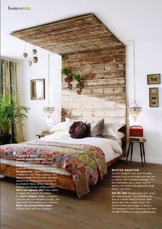 chandeliers. pallet bed. plain sheets w/ colorful quilt. minimal bed side tables.