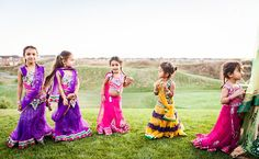 Adorable flower girls in lenghas!  Photo by:Ikonica