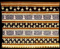 Tapis women's ceremonial skirt. Late 19th C. Cotton and silk couched gold wrapped thread. Unusual figures (angels?) embroidered with silk floss. Seam has been opened. (DT) South Sumatra, Indonesia Source : http://www.indonesiatravelingguide.com/sumatera-traditional-textiles/south-sumatra-textiles/