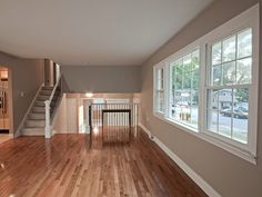 Gleaming hardwood floors plus a gorgeous paint color in the living room of a renovated split-level.