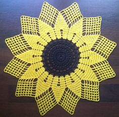 Sunflower doily from cotton thread in bright yellow and black colors. This doily will be a perfect centerpiece for your table. Great as a summer or autumn home decor or wonderful as a gift for someone special. This listing is for 1 sunflower doily. The doily measures 30 cm in diameter. Shipped lightly starched. Custom order or buying more than one item? I can combine shipping, just use the contact seller button above and let me know what you need. For more lovely crochet doilies please…