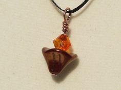UU Chalice Jewelry  Pendant with Bronze Luster Czech Glass and Swarovski Fireopal Flame, by jUUwelry on Etsy
