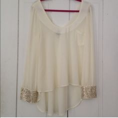 HP ✨ Hi-Lo Cream Blouse Beautiful blouse with gold stud detailing around cuffs. Little front pocket. Sloped front neckline and V back. Never worn!  1/6 Daytime to Date Night party host pick! Very J Tops Blouses