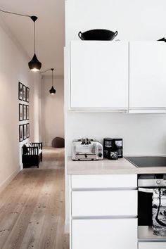 White Scandinavian kitchen, black and white and wood.