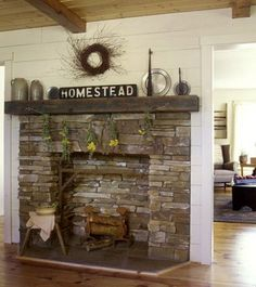 The Green House Effect - Hearth and Home Tracy Jones' custom-built Washington house includes a fantastic old-fashioned fireplace built with rectangular rocks of various thicknesses. Bouquets of wildflowers strung upside down across the front add a dash of natural color, and a pair of pewter plates placed on the mantel contribute a dash of shine. This room was featured in the May 2008 issue of Country Sampler Magazine. - Country Sampler