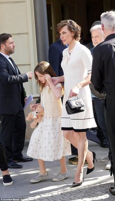 Hand-in-hand: Milla Jovovich stepped out with her lookalike daughter Ever Gabo in Berlin on Monday