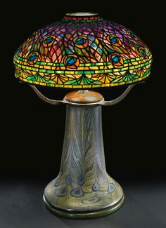 "Tiffany Studios, New York, Favrile Leaded Glass and Patinated Bronze ""Peacock"" Lamp. Tiffany Stained Glass, Stained Glass Lamps, Tiffany Glass, Leaded Glass, Louis Comfort Tiffany, Antique Lamps, Antique Lighting, Vintage Lamps, Victorian Lighting"