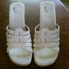 Slip on shoes White with a neat design on the front white mt. Shoes Flats & Loafers