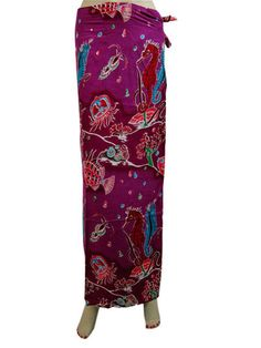 Dark Violet colored tie-dye Wrap Around Skirts with eye-catching floral print creates a Fascinating look 100% Cotton. These long skirts look elegant and give out a style statement as these are in step with the latest fashion trends.