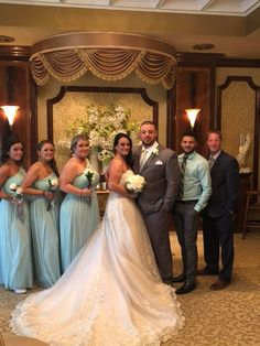 89976c7fe1e2 Off the shoulder bridesmaid dresses in light turquoise compliment a  strapless wedding dress. Get tips