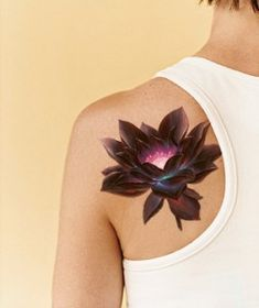 I absolutely adore the effect the tattoo artist has managed to create here - the flower itself is dark and almost translucent, and then the center looks like it's lit up from the inside. Perfectly stunning. - CR