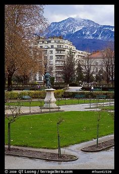 Public garden and snowy mountains. Grenoble, France