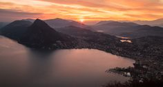 Fire over the city... Great sunset in Lugano ( Southern Switzerland ) shot from Monte Bre' ( 900 meters above sea level ).  Bre sopra Lugano, Canton of Ticino, Switzerland.